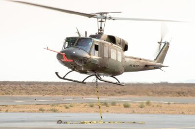 Pilots training in a helicopter at the at National Test Pilot School