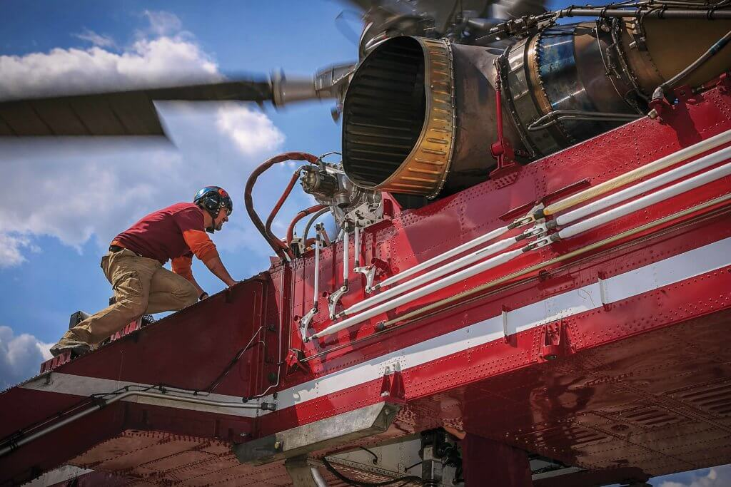 Mechanic works on Sikorsky CH-54