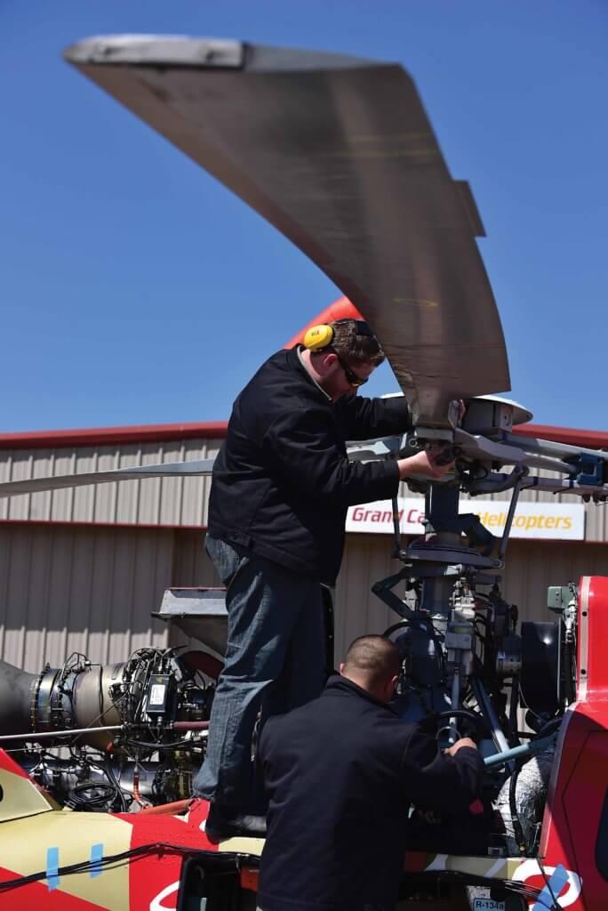 Mechanics working on main rotor hub